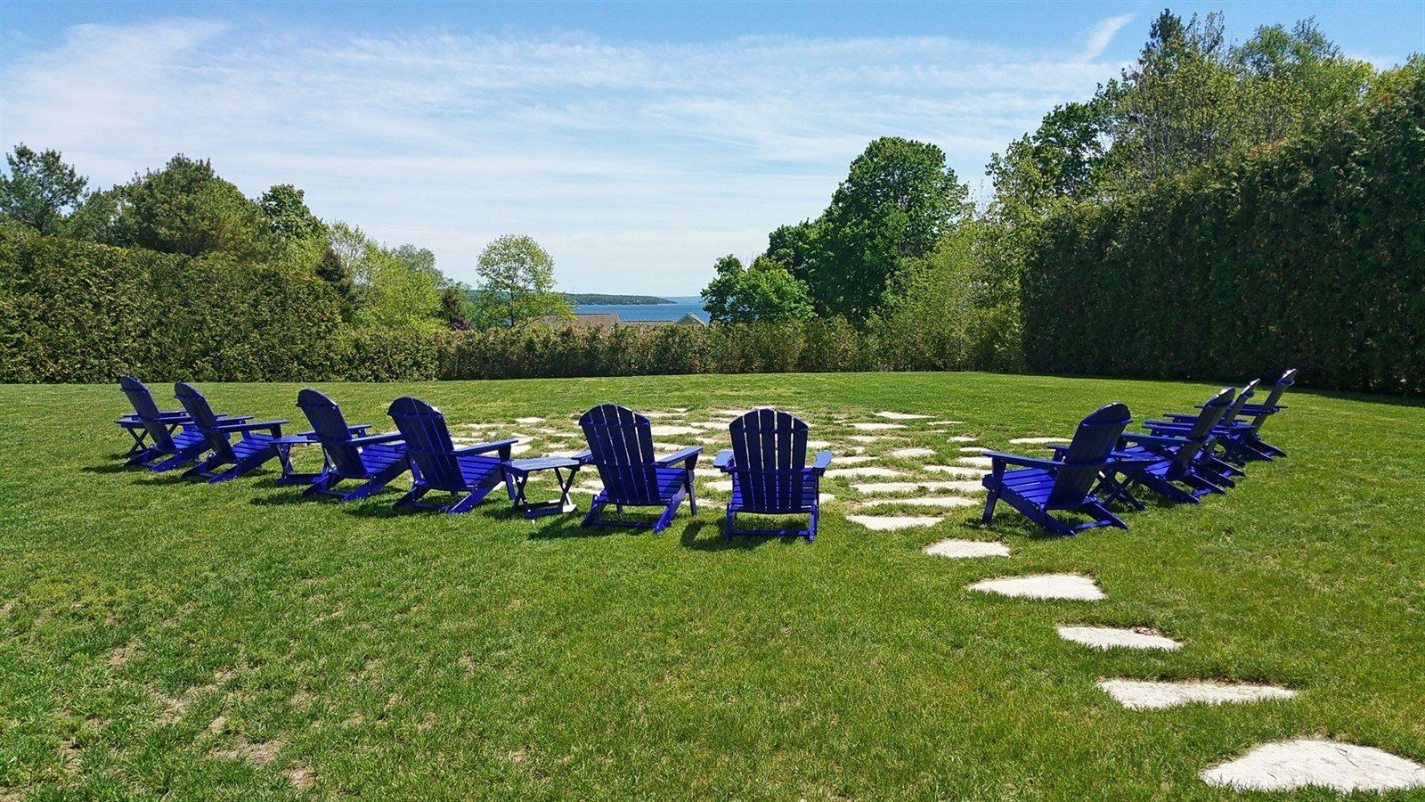 Chairs overlooking the lake at our Charlevoix hotel